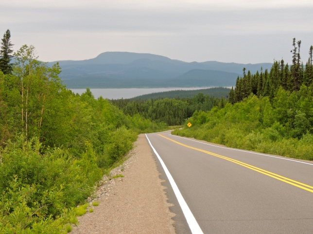 Northern Quebec is a vast area of wilderness broken only occasionally by industry. One of the largest dams in the world is along this highway and at the Labrador border they're literally taking a mountain apart for its ore.